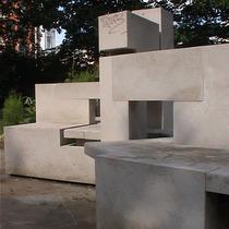 Sculptured stone bench