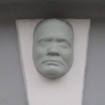Death mask on keystone