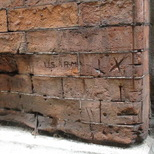 GI graffiti on bricks